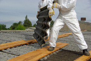 construction worker removing asbestos