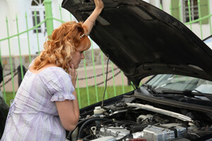 woman near the broken recalled automobile