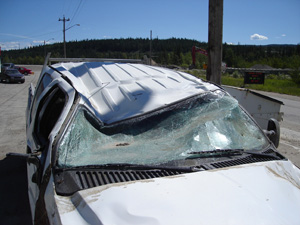 Rollover car with roof crush damage