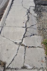 Cracked sidewalk premises liability