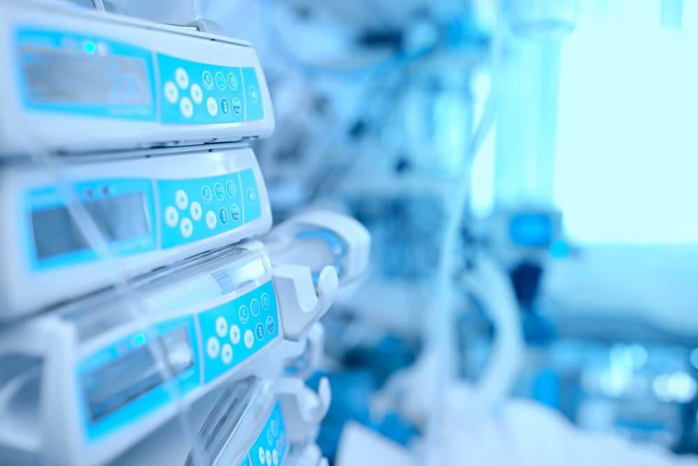 medical diagnostics and measuring devices shown in front of blurred medical background