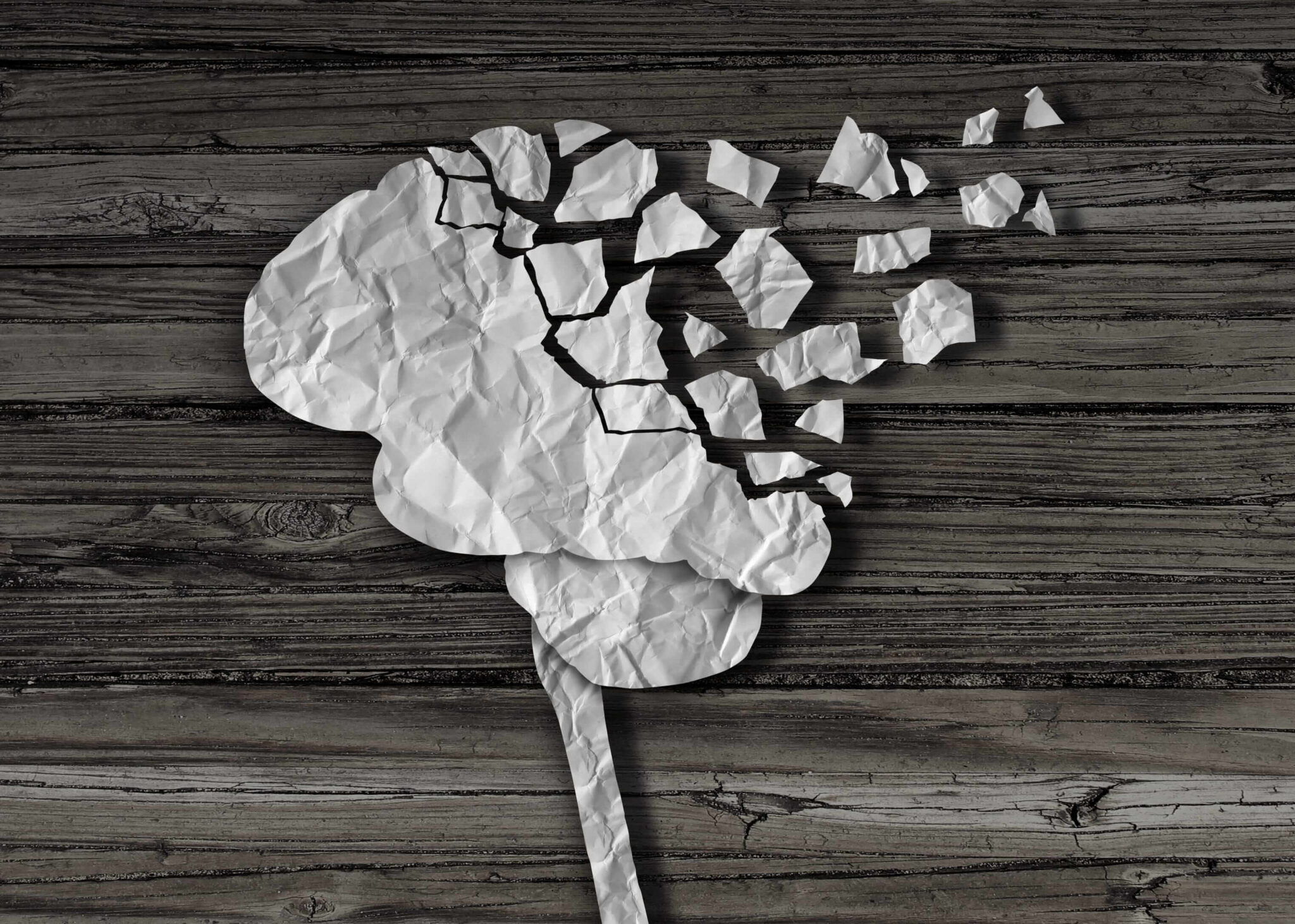 brain icon made of brittle material with pieces broken off