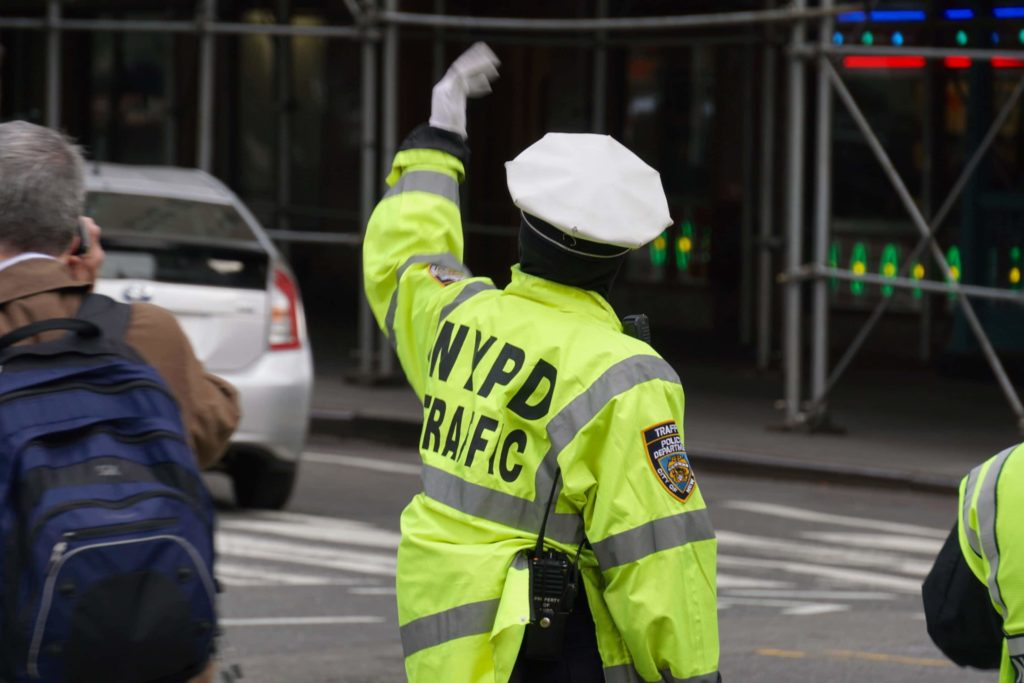 New York Police Department Traffic Enforcement Agent directing traffic at inersection