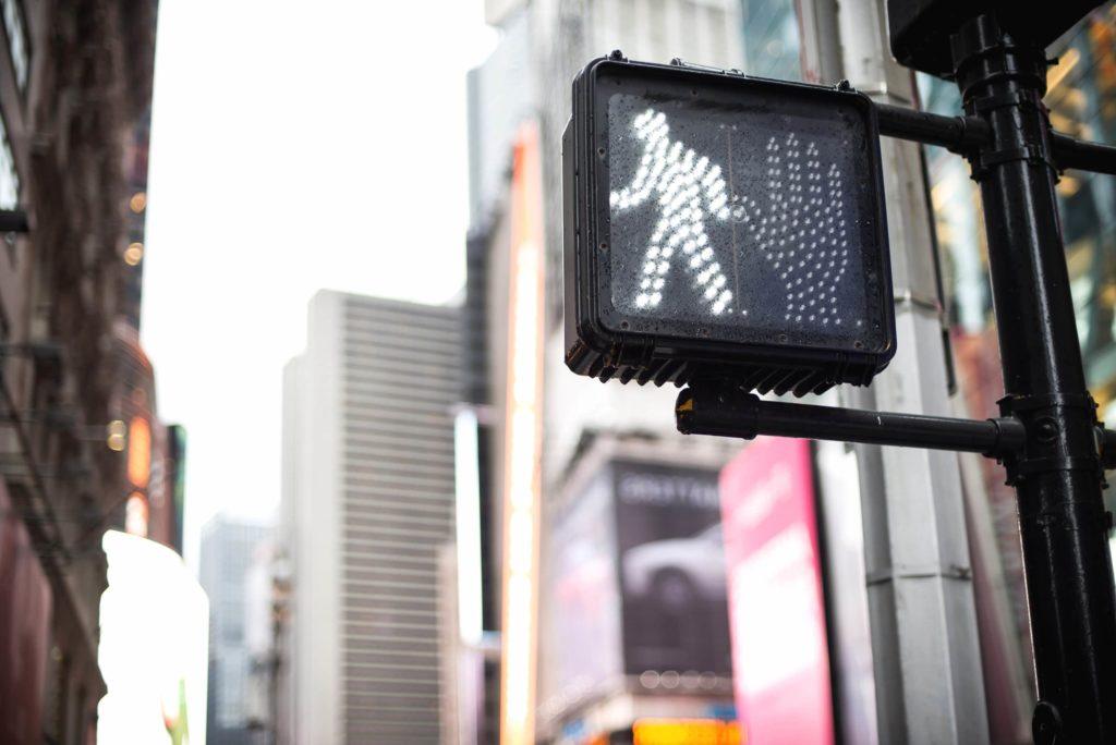 Cross walk signaling the walk sign.