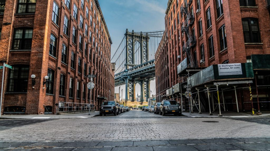 A view of the Manhattan Bridge though a cobblestone street in Brooklyn.