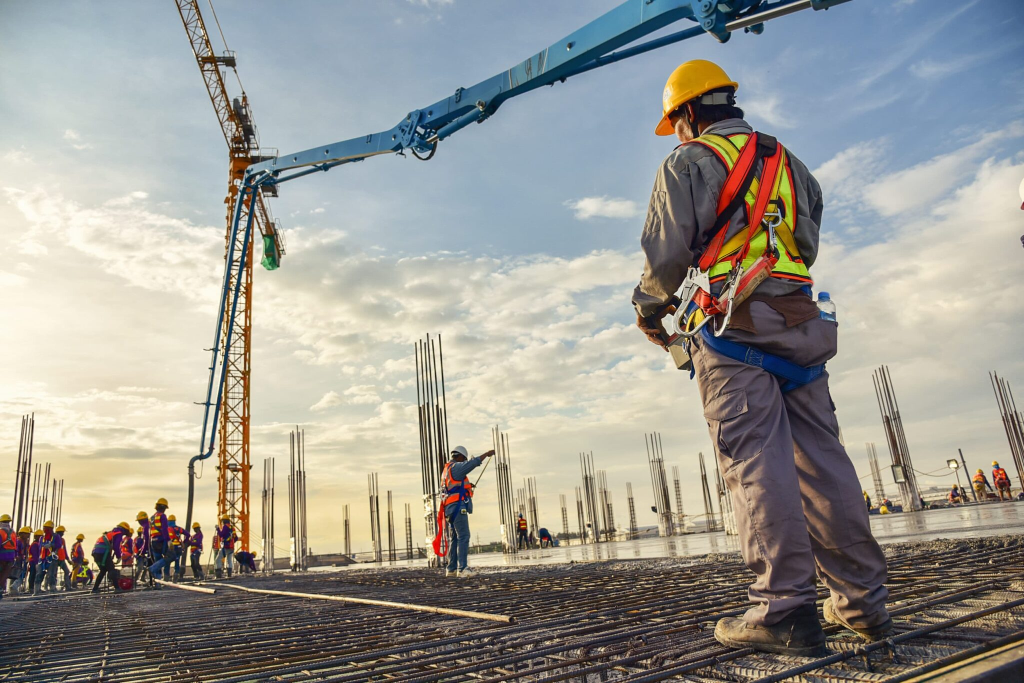 A construction worker is shown on a construction site.