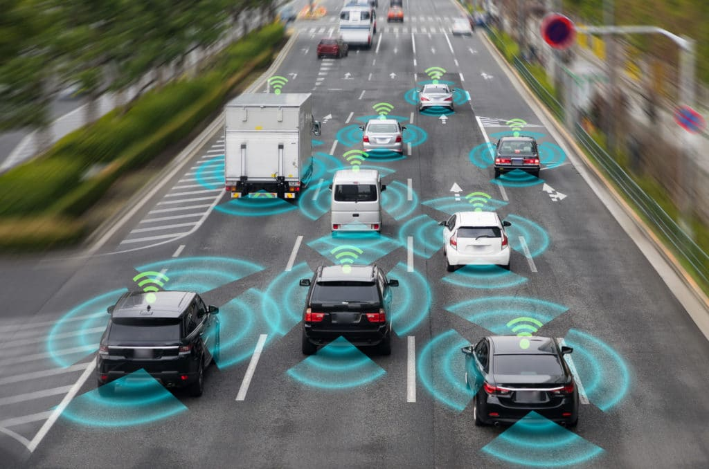 Cars with wireless networks shown on the highway