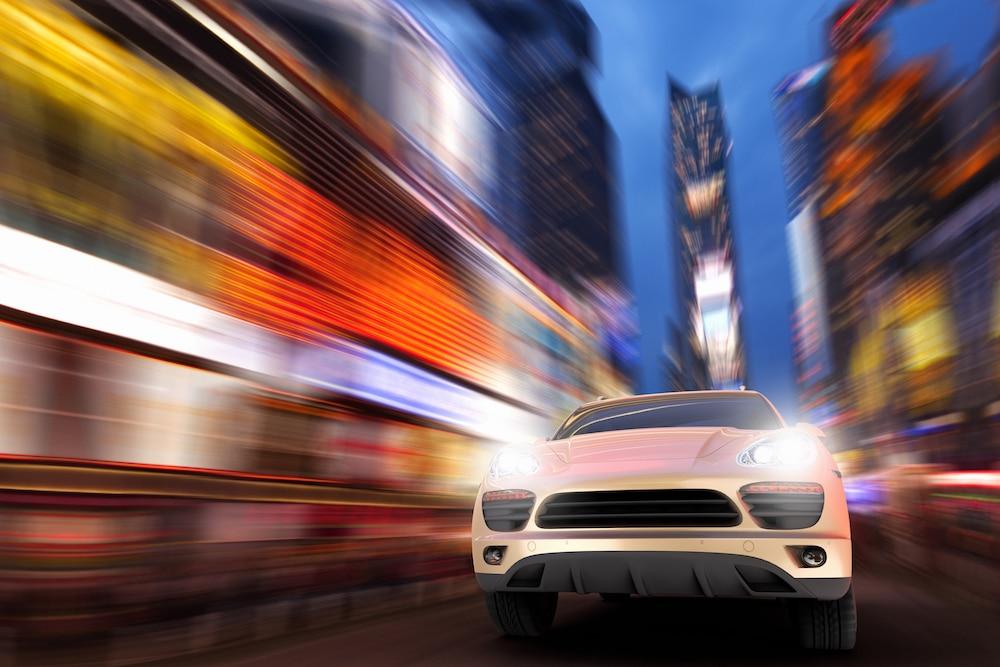 An SUV drives in an urban setting